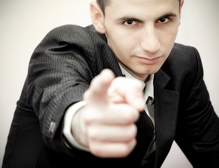 Young business man showing confidence photo