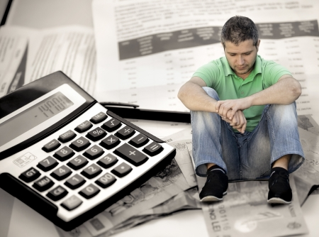 Young man with fear of bills Stock Photo - 10814715