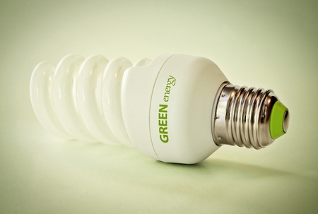 reprocessing: Close up of a light bulb on green background
