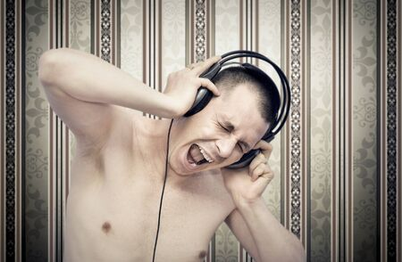 Young man enjoying music on headphones photo