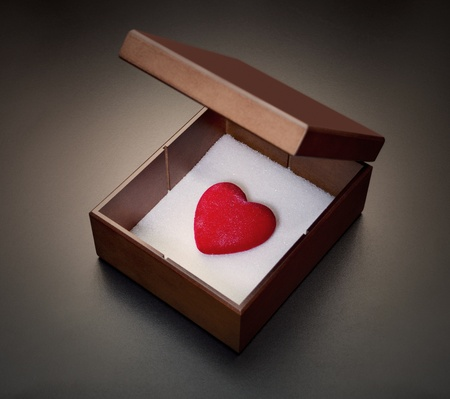 Red heart in a wooden box photo
