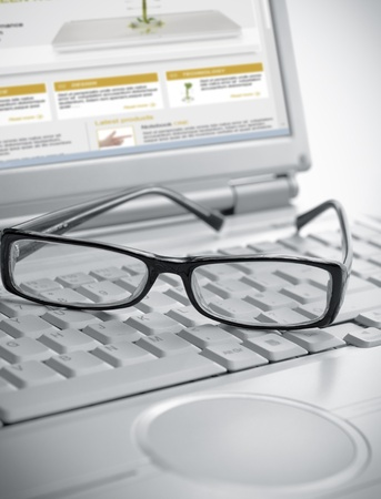 Pair of glasses sitting on laptop keyboard Stock Photo - 12116287