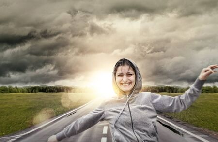Young girl laughting and running on sunset Stock Photo - 12341670