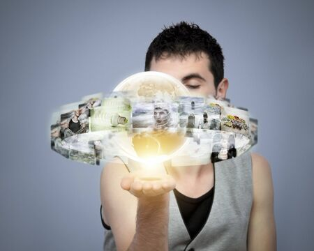 Young man holding global media in his hand Stock Photo - 12341671