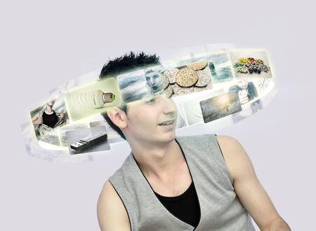Young man looking at virtual photos Stock Photo - 12341673