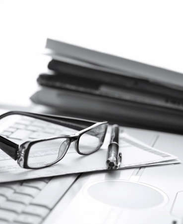 Pair of glasses sitting on laptop Stock Photo - 12712536