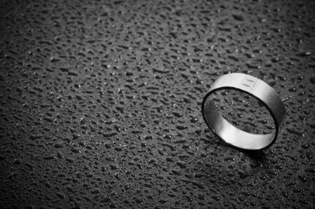 weeding: Close-up of a weeding ring on dark background