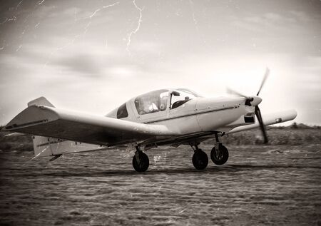 simulate: Vintage image of a plane take of:NOTE-Texture was added to simulate an old image. Stock Photo