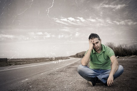 Old photo of a young man sitting out of the road:NOTE-Texture was added to simulate an old image.