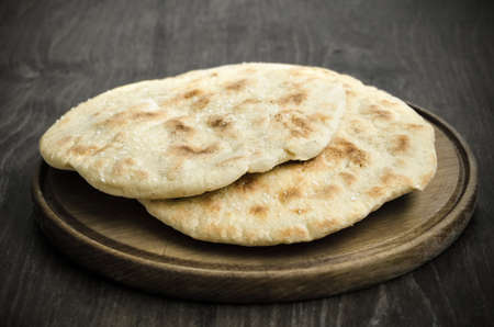 close up image: Close up image of two home made breads with wooden background Stock Photo