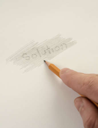 Businessman searching hidden solutions on paper photo