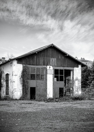 Black and white image of  abandoned warehouse photo