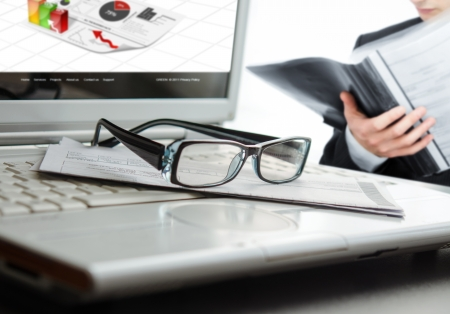 Businessman analyzing a contract at office with selective focus on glasses Stock Photo - 14796206