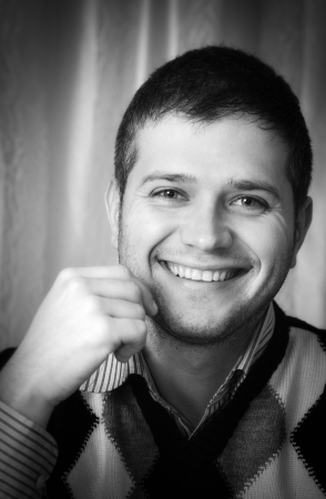 Black and white portrait of a happy young man