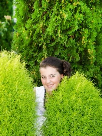smilling: Smilling little girl against green background