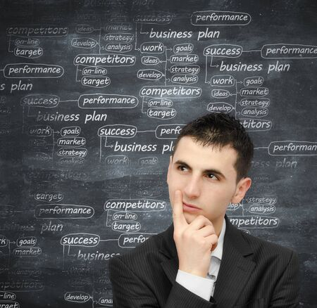 Young man thinking at a business plan Stock Photo - 15259786