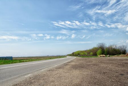 Country road with blue sky in the summer photo