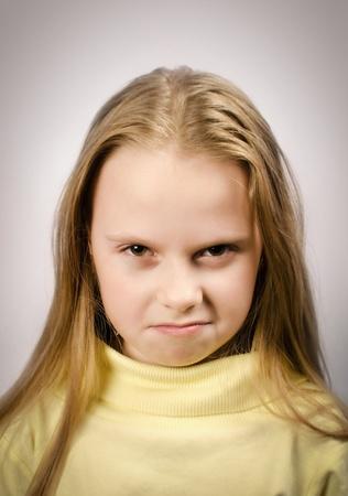Grumpy little girl with an attitude Stock Photo - 16479794