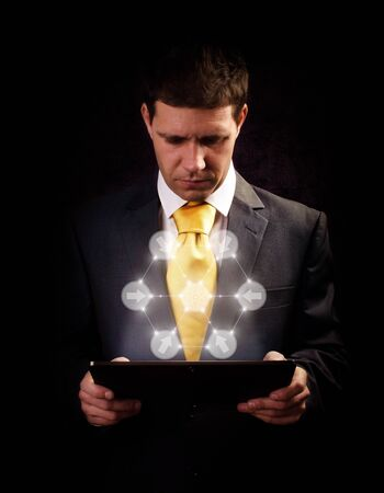 Business man working on digital tablet Stock Photo - 16546660