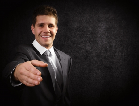 Young businessman offering his services Stock Photo - 16549408