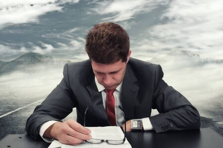 Young man at office reading an application form Stock Photo - 16854987