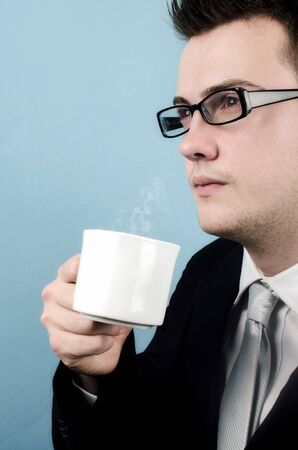 Young businessman taking a coffee break Stock Photo - 17210548