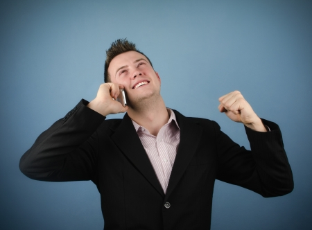 winning stock: Businessman closing a deal on the phone Stock Photo