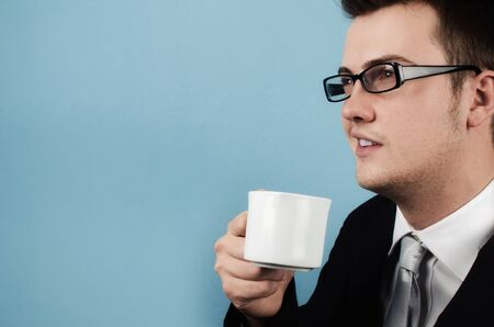 Young businessman making a coffee break and thinks about the future with optimism Stock Photo - 17279816