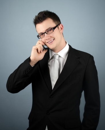 Businessman giving assistance over the phone Stock Photo - 17334378