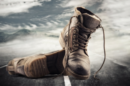 Hiking boots thrown on the street Stock Photo - 17404555