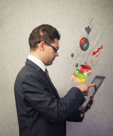Businessman analyzing a chart on a tablet Stock Photo - 17447936