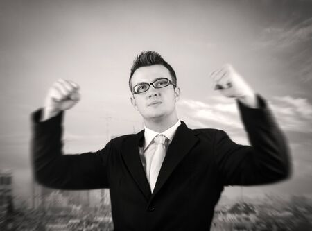 winning stock: Businessman showing  his victory.Motion blur to his hands