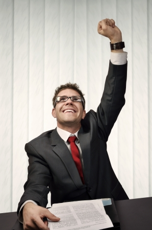 Young businessman who enjoys to win a contract photo