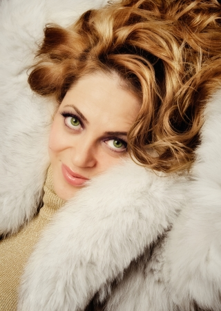 smilling: Beautiful fashion women wearing a furry coat and smilling at camera