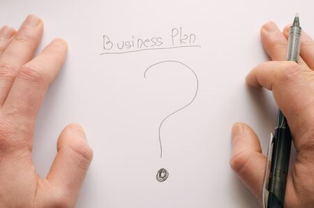 Businessman thinking to  a business plan photo