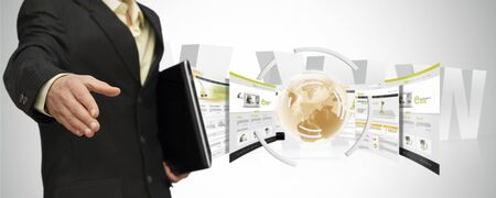 compostion: Young businessman offering his services online Stock Photo