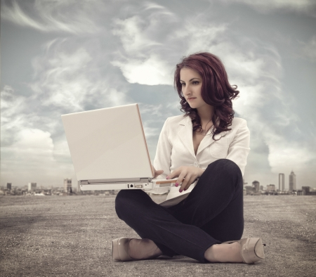 Businesswomen sitting and working with laptop Stock Photo