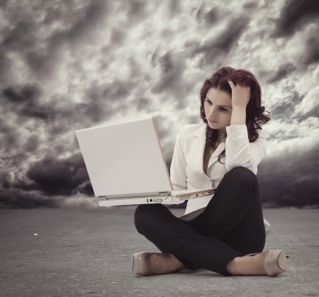 Frustrated Young woman sitting on the floor and  looking at the computer Stock Photo - 21884162