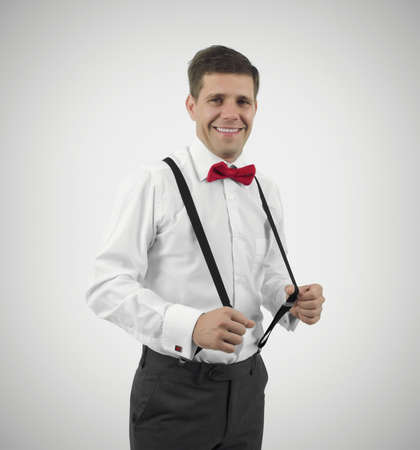 Well dress young man looking and smiling at camera Stock Photo - 21937947