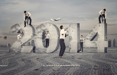 Team of elegant peoples working in advance for the new year 2014 photo