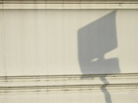 shadow of signboard on white ancient wall Stock Photo