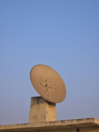 demode: old satellite dish on the roof of building Stock Photo
