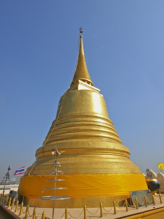 golden pagoda on top of golden moutain in daylight Stock Photo