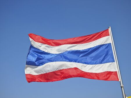 thailand flag blown by wind in sunny day