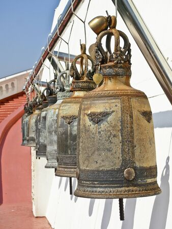 arrange of ancient bells between gateway  at golden mountain Stock Photo