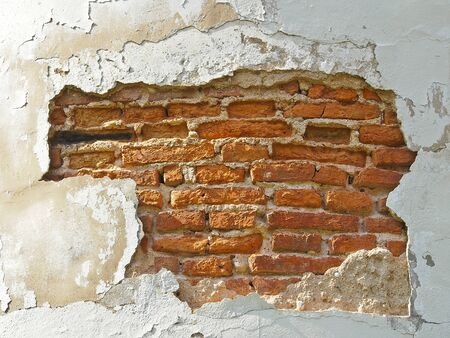 old wall is show structure inside by breken for long time Stock Photo