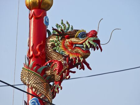 top of pillar red dragon in city Stock Photo