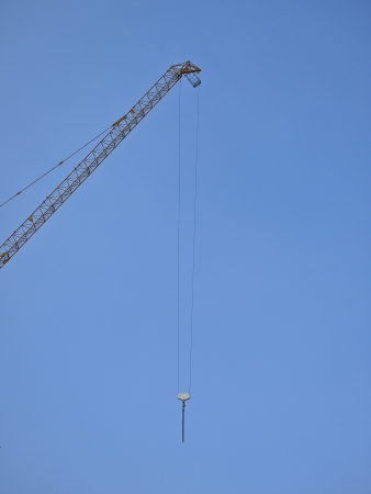 part of crane high in clear sky
