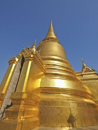 beautiful golden stupa of grand palace in clear sky