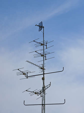 multi antenna high in sky with cloud Stock Photo